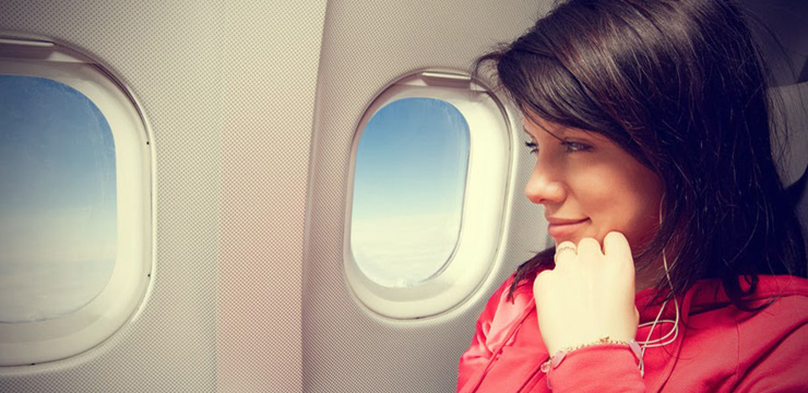 Woman-Sitting-In-The-Airplane1