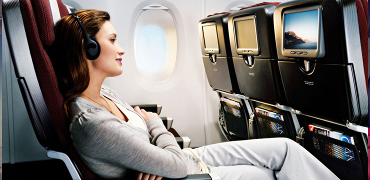 Woman-Sitting-In-The-Airplane2